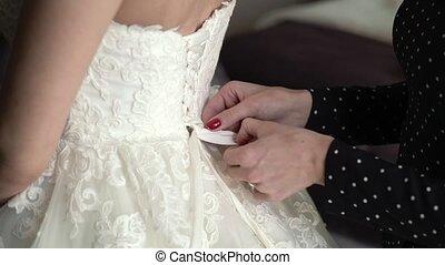 Put on wedding dress, tie