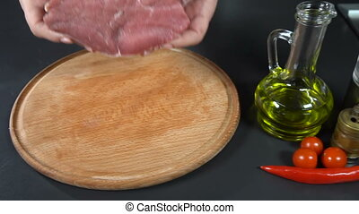 Put the meat on a cutting board. slow motion