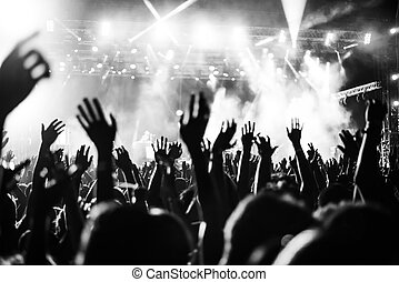 Put your hands up in the air! - Black and white photo of...