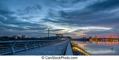 Putrajaya Lake Sunset - Modern building sunset by a dam at...