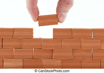 putting a brick in a wall