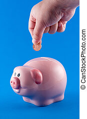 Putting a coin in a piggy bank