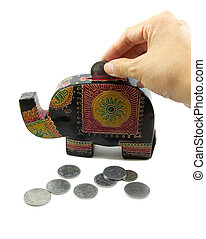 Putting a coin in to a elephant bank.