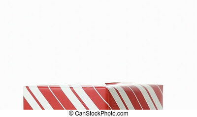 Putting A Red Bow On Top Of A Christmas Gift