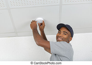 putting a smoke detector