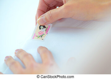 Putting a stamp on a letter