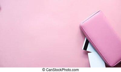 putting credit card in a women purse .
