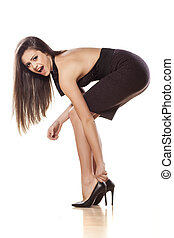 putting high heels - nervous young woman puts on her high...