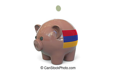 Putting money into piggy bank with flag of Armenia. Tax system system or savings related conceptual 3D rendering