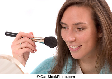 Putting on my makeup - Pretty brunette putting on blusher