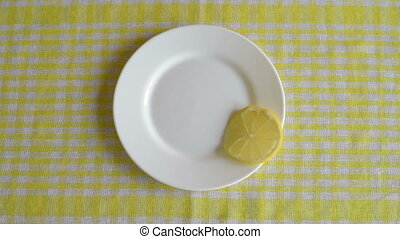 Putting pieces of lemon on a plate