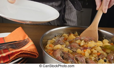 Putting quail stew on a plate - Putting quail legs and...