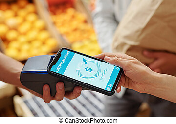 Putting smartphone to terminal while paying for products