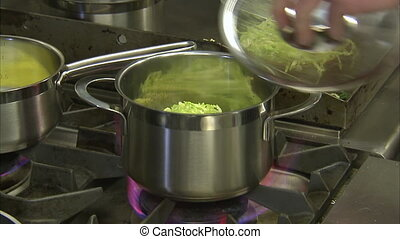 Putting stripped cabbage on a pot