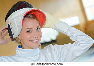 putting the fencing helmet
