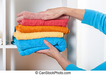 Putting towels on shelf