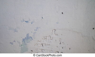 Putty wall aligning with plaster in room, renovation ...