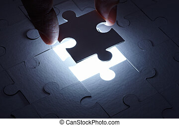 puzzle game solution teamwork - close up of a puzzle game ...