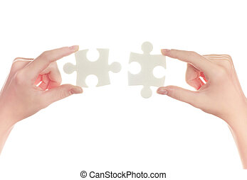 puzzle in hand isolated on white background