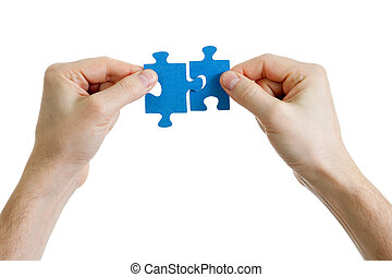 puzzle in hands on white background