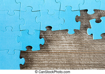 Puzzle on brown wooden surface