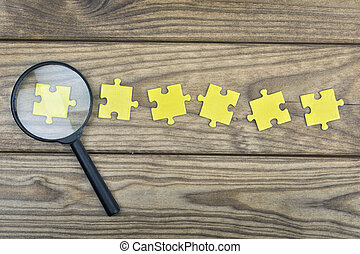 Puzzle on wooden table