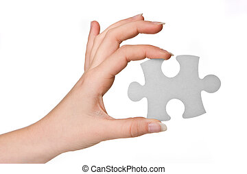 Puzzle piece - Hands of a woman holding a puzzle piece