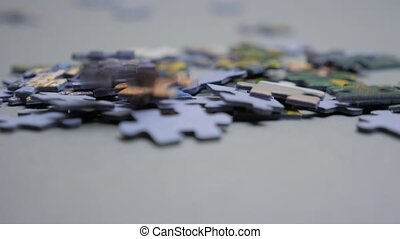 Puzzle pieces falling down. Business concept for key ...