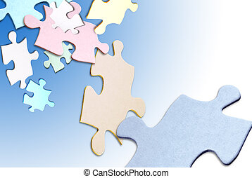 Puzzle pieces floating - Colored puzzle pieces floating over...