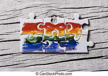 puzzle pieces forming a rainbow flag - some pieces forming a...
