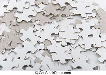 Puzzle Pieces - Background of numerous mixed blank puzzle...