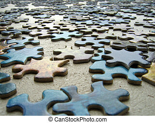 Puzzle Pieces - Puzzle pieces scattered on a table