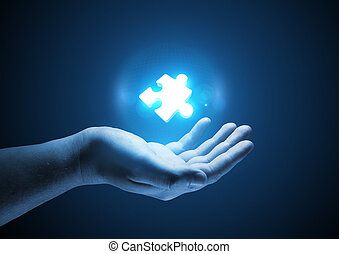 Puzzle Solutions. Conceptual illustration. A man holding a...