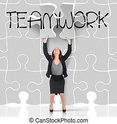 Puzzle teamwork - Woman enters a big missing puzzle piece