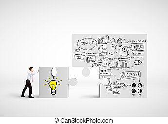 puzzle with business plan - businessman moving puzzle with...