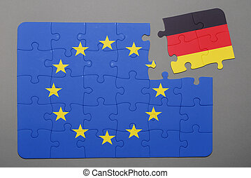 Puzzle with flag of european union and germany piece detached.