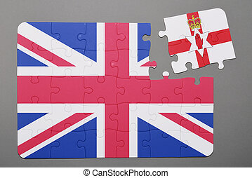 Puzzle with national flag of great britain and northern ireland piece detached.