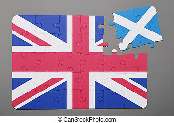 Puzzle with national flag of great britain and scotland piece detached.