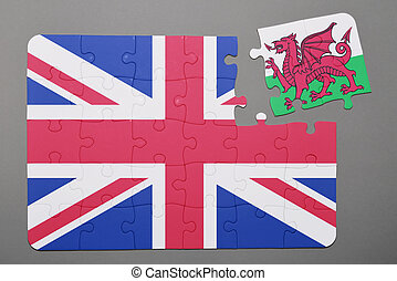 Puzzle with national flag of great britain and wales piece detached.