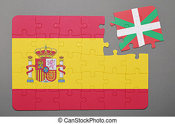 Puzzle with national flag of Spain and Basque Country piece detached.