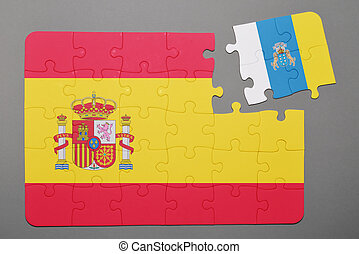 Puzzle with national flag of Spain and canary islands piece detached