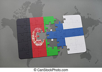 puzzle with the national flag of afghanistan and finland on a world map background.