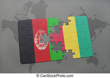 puzzle with the national flag of afghanistan and guinea on a world map background.