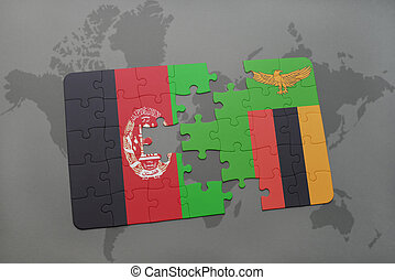 puzzle with the national flag of afghanistan and zambia on a world map background.