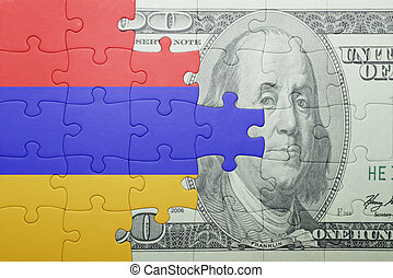 puzzle with the national flag of armenia and dollar banknote