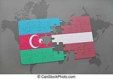 puzzle with the national flag of azerbaijan and latvia on a world map background.