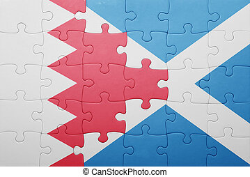 puzzle with the national flag of bahrain and scotland