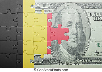 puzzle with the national flag of belgium and dollar banknote