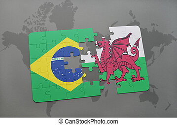 puzzle with the national flag of brazil and wales on a world map background.