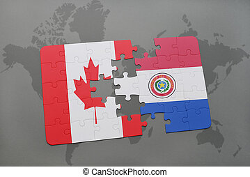 puzzle with the national flag of canada and paraguay on a world map background.